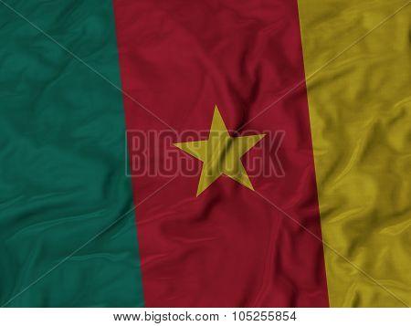 Closeup of ruffled Cameroon flag