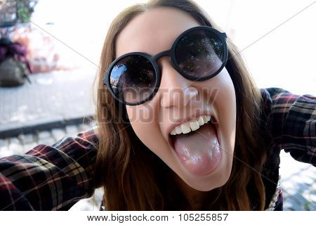 Happy Young Woman Taking A Selfie.