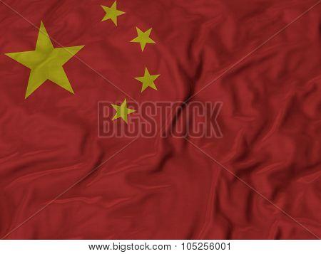 Closeup of ruffled China flag