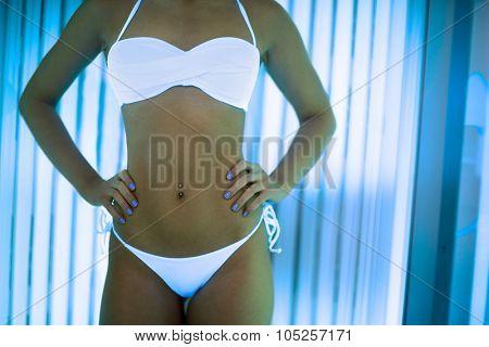 Beautiful girl close up in swimsuit at solarium.