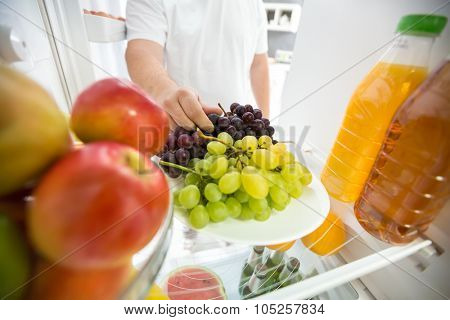Grapes and apples in refrigerator ideal for diet