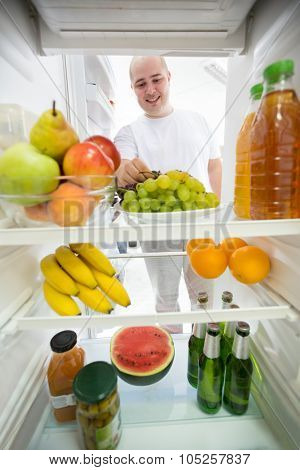 Healthy food and drink with low calories in fridge ideal for diet