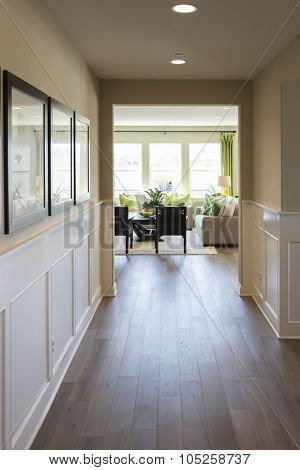 Beautiful Home Entry Way with Wood Floors and Wainscoting.