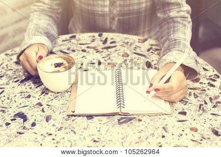 Girl With Blank Diary And Cup Of Coffee