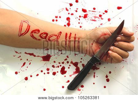 Female suicide with dead messages , Knife and a ring on the hand