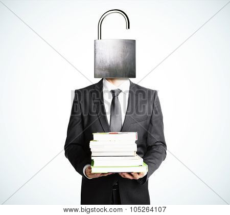Open Your Mind Concept With Businessman With Books