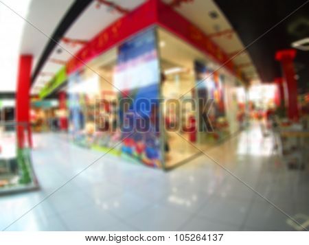 Abstract Blurred Image Of Shops With Fashionable Clothing