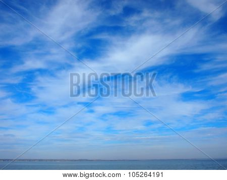 Panorama Of The Sky Over The Lake Of White Cirrus Clouds