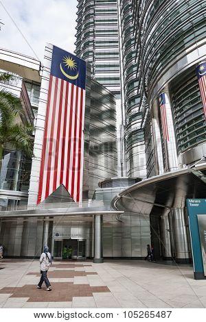KUALA LUMPUR, MALAYSIA - JULY 06, 2009: Large Malaysian flag on Petronas Twin Towers facade.