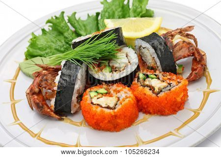 spider roll, maki sushi made of soft shell crab tempura and sushi rice isolated on white background