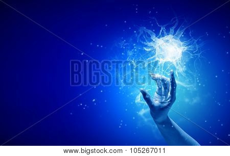 Close up of man hand touching nerve symbol on blue background