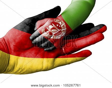 Adult Man Holding A Baby Hand With Germany And Afghanistan Flags Overlaid. Isolated On White