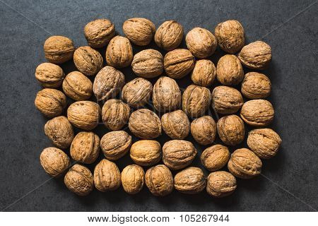 The walnuts on a gray surface