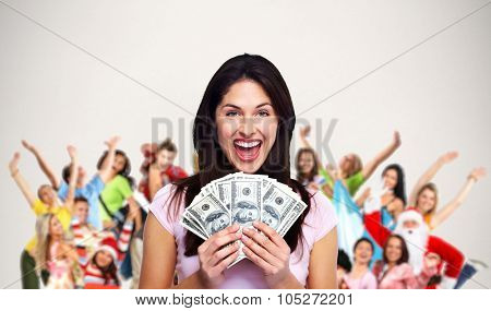 Happy laughing woman holding cash over people group background