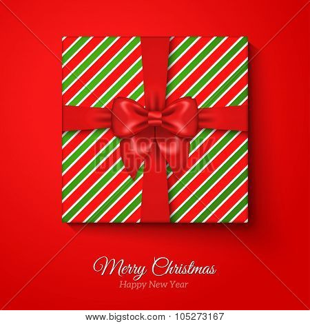 Merry Christmas Greeting Card with Striped Gift Box.