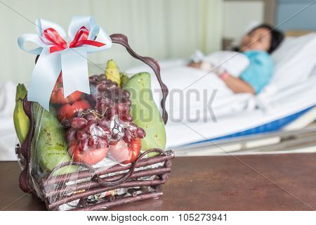 Fruits Basket And Female Patient On The Bed In Hospital Room