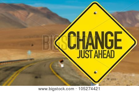 Change Just Ahead sign on desert road