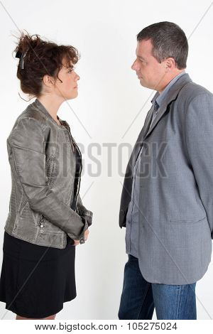 Side View Of A Couple Standing Face To Face And Looking At Each Other,