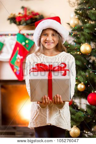 Happy Little Girl Holding Big Christmas Gift Box