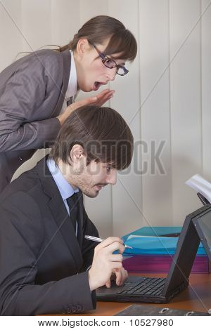 Woman Looking Over Man Shoulder At Computer
