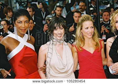CANNES, FRANCE - MAY 22: Singers Natalie Cole, Alanis Morissette and Sheryl Crow arrive  the screening of 'De-Lovely' during the 57th Cannes Film Festival on May 22, 2004 in Cannes, France