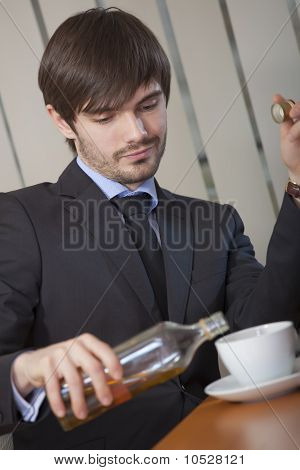 Man Drinking By Office Work