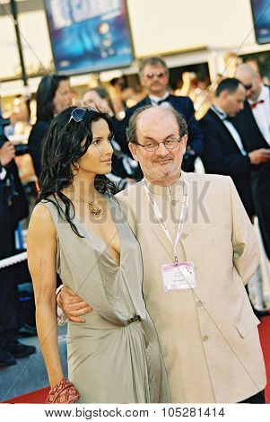 CANNES, France - MAY 16: Anglo-Indian novelist Salman Rushdie and his wife Padma Lakshmi arrive for the film 'Comme Une Image', May 16, 2004 at the Cannes Film Festival. Cannes, France