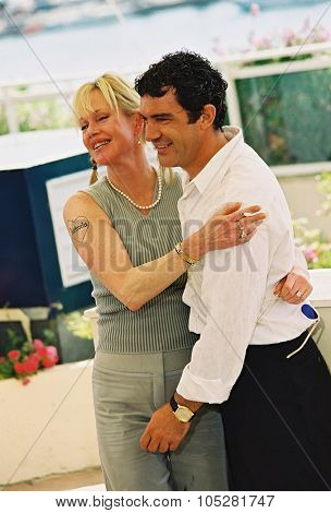 CANNES, FRANCE - MAY 25: Antonio Banderas and Melanie Griffith attand the photocall for the film 'Femme fatale' at the palais des festivals during the 55th Cannes film festival 25 May, 2002 in Cannes, France