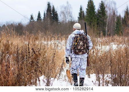 Hunter With Gun On Snowy Field