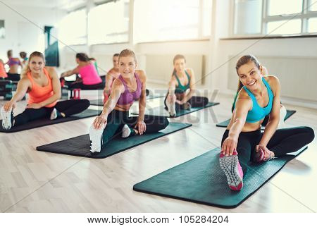 Group Of Young Women In Aerobics Class