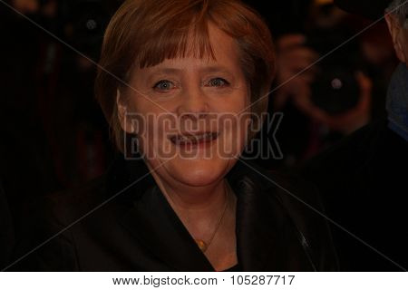 BERLIN, GERMANY - FEBRUARY 13: German Chancellor Angela Merkel attends the 'Pina' Premiere during  of the 61st Berlin Film Festival at Berlinale Palace on February 13, 2011 in Berlin, Germany
