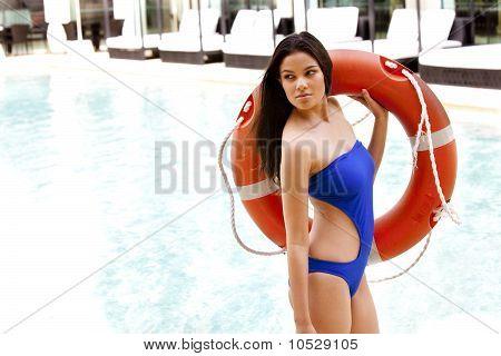 Young Woman In Designer Swimwear