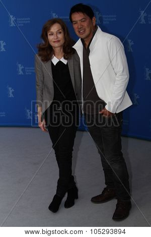 BERLIN, GERMANY - FEBRUARY 12: Isabelle Huppert, director Brillante Mendoza attend the 'Captive' Photocall during of the 62 Berlin Festival at the Grand Hyatt on February 12, 2012 in Berlin, Germany.