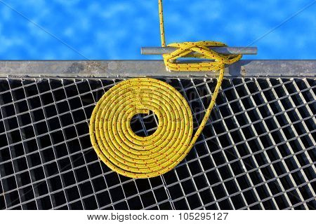 Marine Background Made Of Mooring Rope With A Cleat.