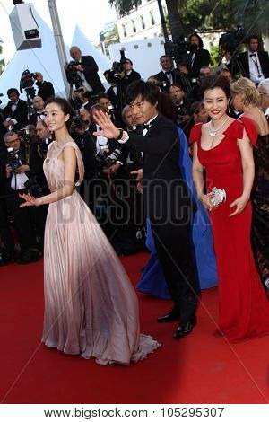 CANNES, FRANCE - MAY 16: Qi Xi, Qin Hao and Hao Lei attend opening ceremony and 'Moonrise Kingdom' premiere during the 65 Cannes  Festival at Palais des Festivals on May 16, 2012 in Cannes, France.