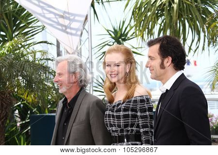 CANNES, FRANCE - MAY 25:   Philip Kaufman, Clive Owen and Nicole Kidman pose at the 'Hemingway & Gellhorn' photocall during the 65th  Cannes Film Festival at Palais on May 25, 2012 in Cannes, France.