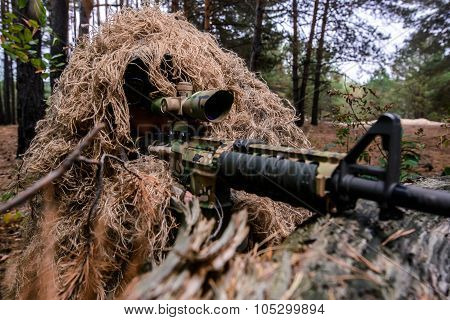 Closeup Of Aiming Sniper With Rifle