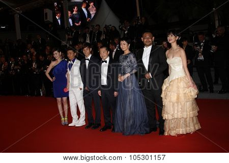 CANNES, FRANCE - MAY 17: Jia Zhangke, Tao Zhao, Jiang Wu, Meng Li attend the Premiere of 'Tian Zhu Ding' (A Touch of Sin) during The 66th Cannes  Festival at Palais  on May 17, 2013 in Cannes, France.