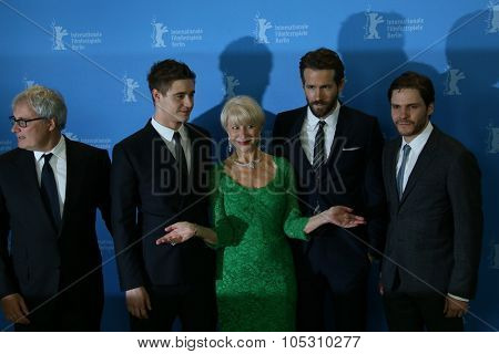 BERLIN, GERMANY - FEBRUARY 09: Helen Mirren, Ryan Reynolds, Daniel Bruehl attend the 'Woman in Gold' photocall during the 65th Berlinale Festival at Hyatt Hotel on February 9, 2015 in Berlin, Germany.