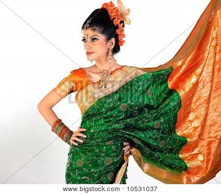 Woman in silk-sari showing her rich border of the sari