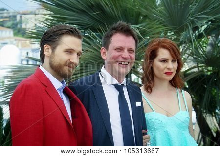 Director Dalibor Matanic (C) and actress Tihana Lazovic (R) attend the 'Zvidan' photocall during the 68th annual Cannes Film Festival on May 17, 2015 in Cannes, France.