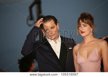 Johnny Depp andDakota Johnson  attend the premiere of the movie 'BLACK MASS' during the 72nd Venice Film Festival on September 4, 2015 in Venice, Italy.