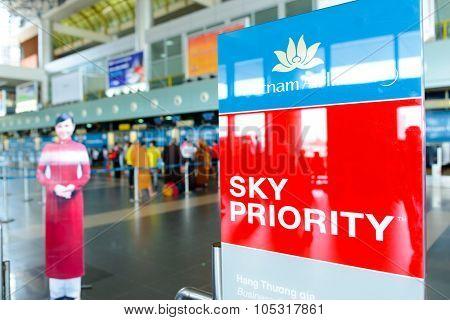 HANOI, VIETNAM - MAY 11, 2015: close up shot of sky priority banner in Noi Bai International Airport. Noi Bai International Airport is the largest airport in Vietnam.