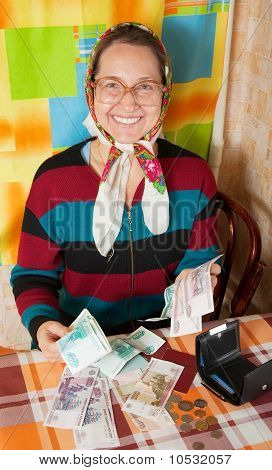 Happy Senior Woman With Money