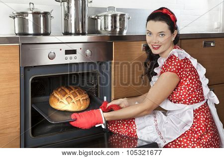Young Housewife Baking Bread