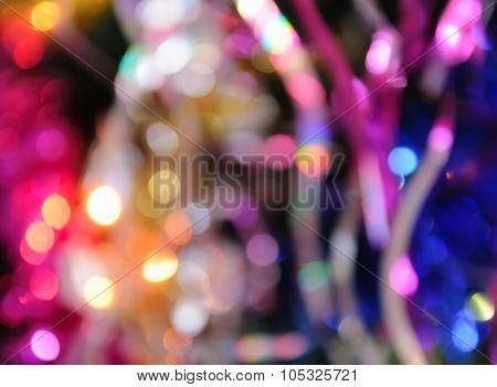 Blurred christmas lights background. De focused Light