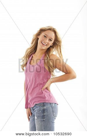 Teenager with long blond hair blowing in breeze