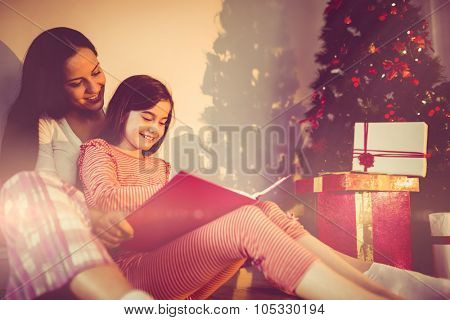 Mother and daughter waiting for santa claus at home in the living room