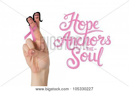Crossed fingers with breast cancer ribbon against hope anchors the soul