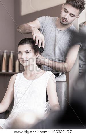 Washing Young Woman's Hair